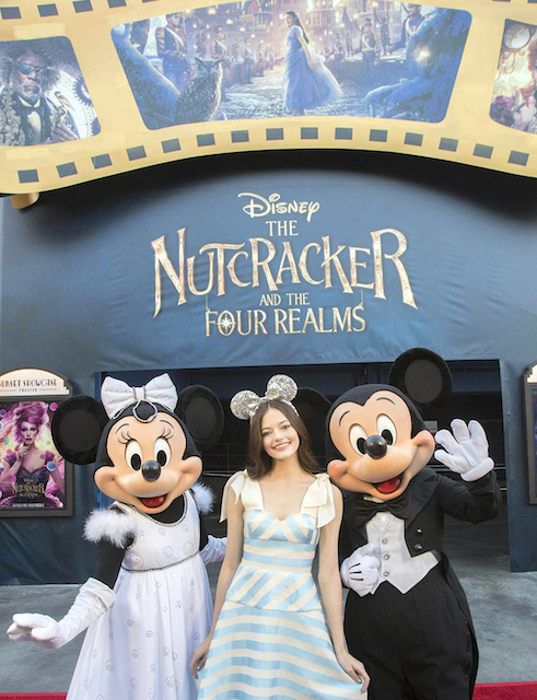 Mackenzie Foy, with Minnie and Mickey. Photo by Joshua Sudock/Disneyland Resort