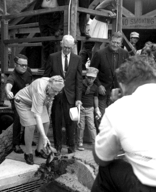 Cordelia and Walter Knott with John Wayne at the Knott's Log Ride opening