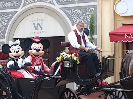 Mickey and Minnie Mouse arrive at Via Napoli