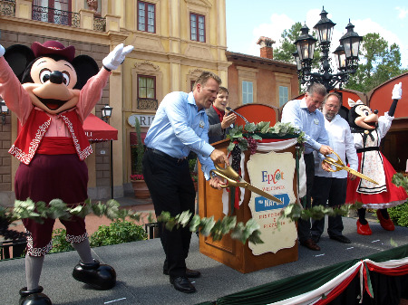 Mickey and Minnie help cut the ribbon to open Via Napoli