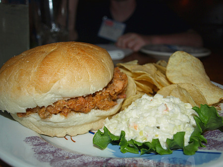 Barbecue sandwich, chips and slaw