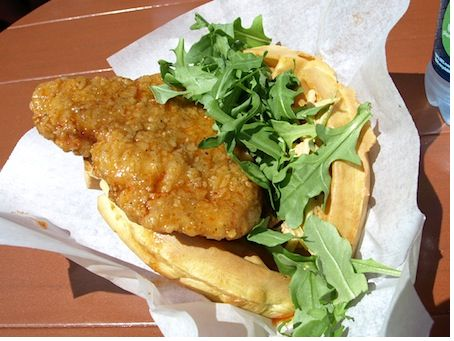 The fried chicken waffle sandwich, with sweet and sour syrup and arugula.