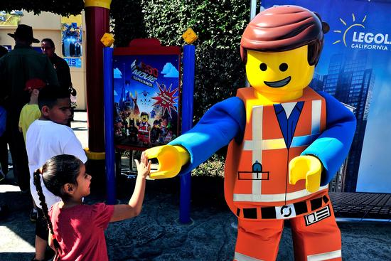 Emmet meets a fan at Legoland California