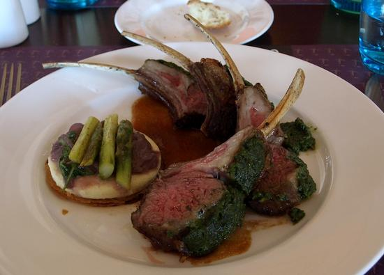 Herb crusted rack of Colorado lamb, presented with a Nicoise-style tart with goat cheese, onions and asparagus
